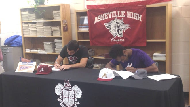 Asheville High's Miles Moore, left, and Devin Mangum have signed to play college baseball.