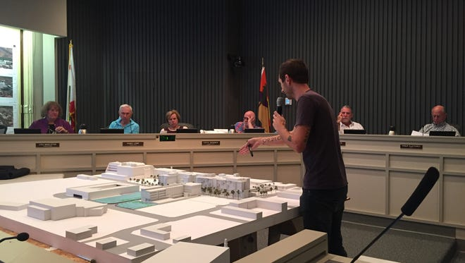 Chris Pardo, of Chris Pardo Design: Elemental Architecture, the lead design firm for the downtown Palm Springs redevelopment project, points to a model depicting the project during a Palm Springs Planning Commission meeting Wednesday.