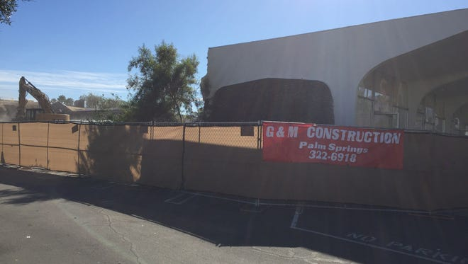 Crews began demolishing the 1950s-era Ramon Drugs building on South Indian Canyon Drive in Palm Springs on Monday.