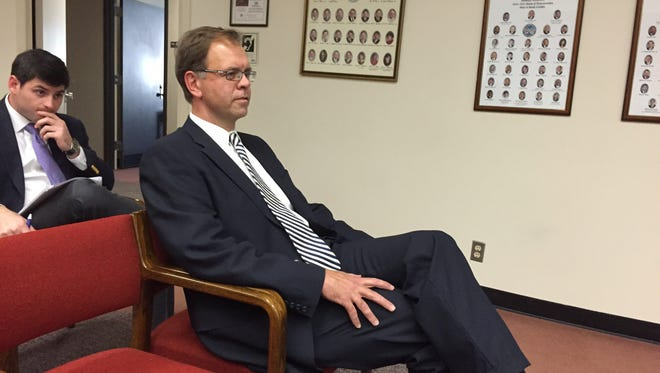 Judge John Few waits tin November to talk to a State Supreme Court selection panel