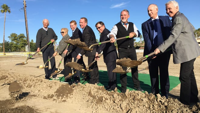 From left, Palm Springs City Council members Chris Mills, Ginny Foat, Rick Hutcheson, Former mayor Steve Pougnet, Mayor Robert Moon, newly elected City Councilman J.R. Roberts, real estate developer Lawrence Rael and newly-elected City Councilman Geoff Kors break ground on the Hyatt Andaz hotel in Palm Springs.