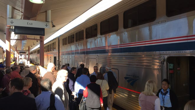 Passengers board the Amtrak Sunset Limited at Union Station in Los Angeles in 2016. Amtrak now allows passengers to take along a small dog or cat for trips less than seven hours long.