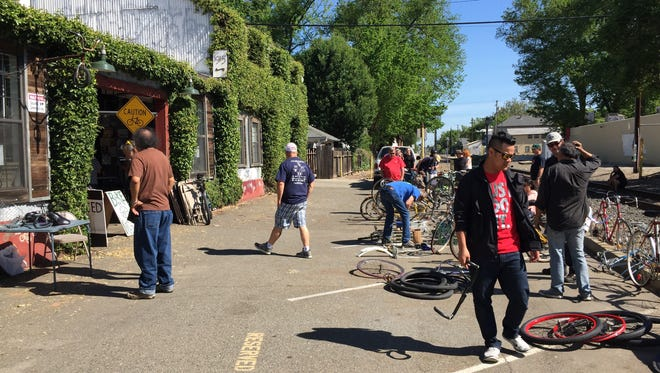 """The Sacramento Bicycle Kitchen, where cyclists can learn low-cost bicycle maintenance, held a """"bike swap meet"""" Sunday morning where riders gathered to check out bikes and parts and did some trading."""