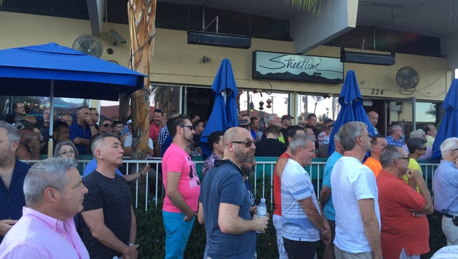 Patrons at Streetbar and other Arenas Road bars in Palm Springs spill into the street Sunday evening to hear speakers at a vigil called in the wake of a mass-shooting in an Orlando, Florida gay club that has left 49 people dead and dozens injured.