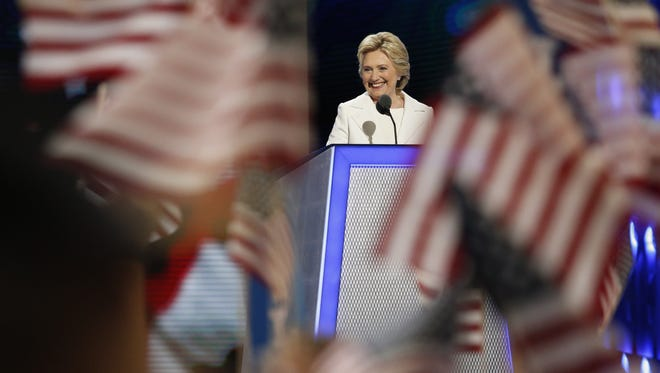 Hillary Clinton addresses the Democratic National Convention on Thursday. The four days were filled with internal party fighting, but Clinton sought to bridge the divide.