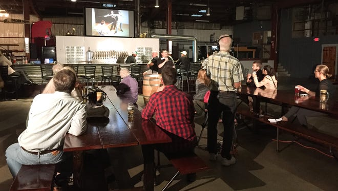 A community gathers at the 3 Sheeps Taproom to listen to impassioned five-minute speeches during Ignite Sheboygan. The next event is at 5:30 p.m. on Feb. 13.