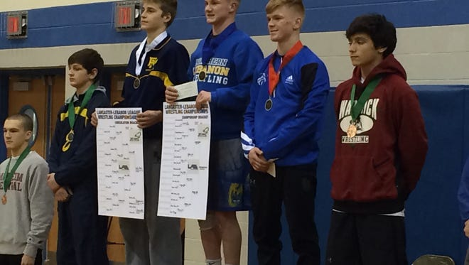 Northern Lebanon's Colin Leonard reached the top of the medal stand on Saturday after winning the 126-pound title at the Lancaster-Lebanon League Wrestling Championships, held at Garden Spot High School.