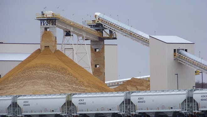 Frac sand destined for the oil and gas fields piles up at the EOG Resources Inc. processing plant in Chippewa Falls in December 2011.