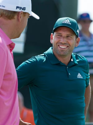 Sergio Garcia (right) socializes while waiting to tee  off on the 10th hole during a U.S. Open practice round Tuesday.