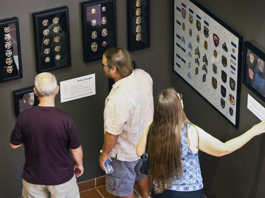 Museum founder and curator, Ret. Officer Dan Kallberg has collected badges, patches and other memorabilia from the 100 years of the Glendale Police Department at the opening of the new home of the Glendale Police Museum in the lobby of the downtown Glendale police station.