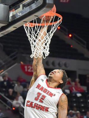 UL's Bryce Washington dunks the ball against South Alabama earlier this season.