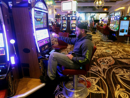 Anthony Palermo of Rochester plays a slot machine on opening day of del Lago Casino.