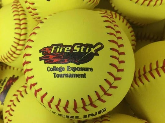 A Michigan county will spend $50,000 to keep softballs