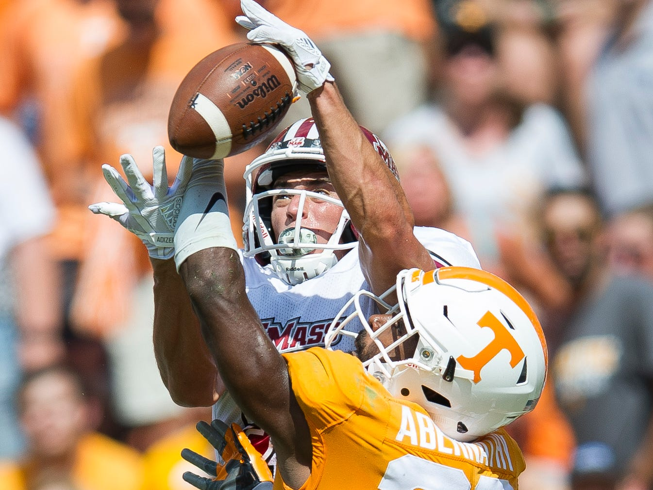 Tennessee defensive back Micah Abernathy (22) breaks up a pass intended for UMass wide receiver Andy Isabella (23) during Tennessee's game against UMass in Neyland Stadium on Saturday, Sept. 23, 2017.
