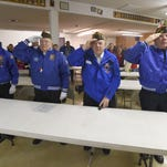 Veterans, from left, John Medlin, Buzz Friesenhahn, Curt Cameron, and Bob Barnet, stand and salute as they recite the Pledge of Allegiance during a 2014 Veterans Day ceremony at the American Legion in Laporte.