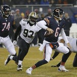 Junior Galette (93) chases Chicago Bears quarterback Jay Cutler (6) before a sack Dec. 15.