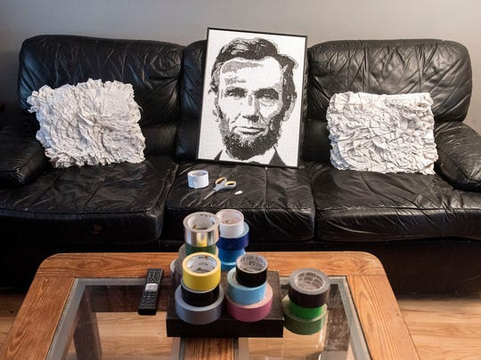 A portrait of President Abraham Lincoln rests on Kerry Mott's couch, where she does most of her duct tape art, Tuesday, March 7, 2017. Hundreds of hours and thousands of pieces of duct tape go into making such a piece.