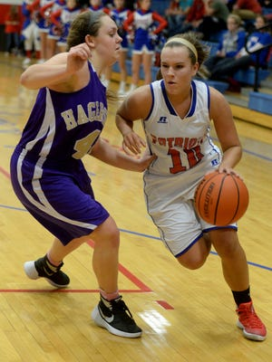 Union County's Sierra Dowler moves the ball against Hagerstown's Brytni Dale during a girls basketball game Wednesday, Dec. 9, 2015, in Liberty.