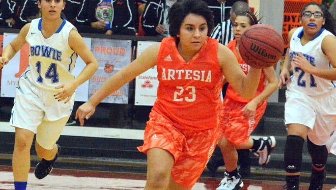 Artesia junior guard Jada Ornelas leads a fast break attempt in the third quarter Thursday against El Paso Bowie.