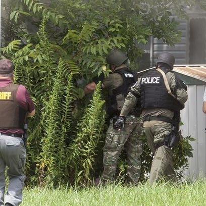 Police close in on a garage where Shawn Ruble was hiding