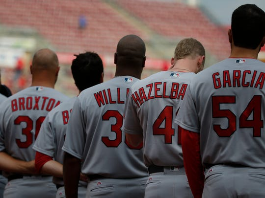 St. Louis Cardinals left fielder Jeremy Hazelbaker (41), bows his head during the national anthem prior to the game between the St. Louis Cardinals and the Cincinnati Reds on Aug. 2, 2016, at Great American Ball Park in Cincinnati.