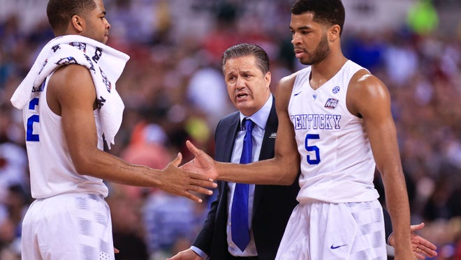 UK's Andrew Harrison greets brother Aaron Harrison, left, with John Calipari in the background during the game against Wisconsin in the 2015 Final Four. The Badgers beat Kentucky 71-64 in the semifinal Saturday at the Final Four at Lucas Oil Stadium. By Matt Stone, The C-J April 4, 2015.