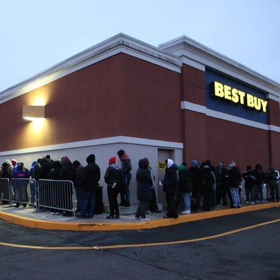 People wait in line at the Best Buy on Central Park