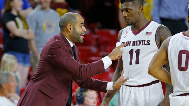 Stan Johnson talks to Savon Goodman during a game against California on March 7, 2015 in Tempe.