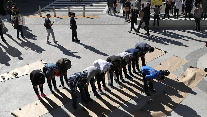 Muslim men pray during a demonstration against the immigration ban that was imposed by President Trump at Los Angeles International Airport on Jan. 29, 2017.