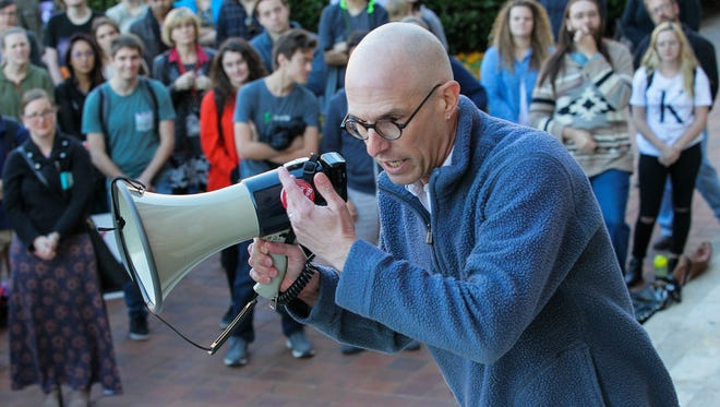 Todd May, a professor at Clemson University, speaks to protesters  during the March Against Silence on Thursday in front of Sikes Hall at Clemson University.