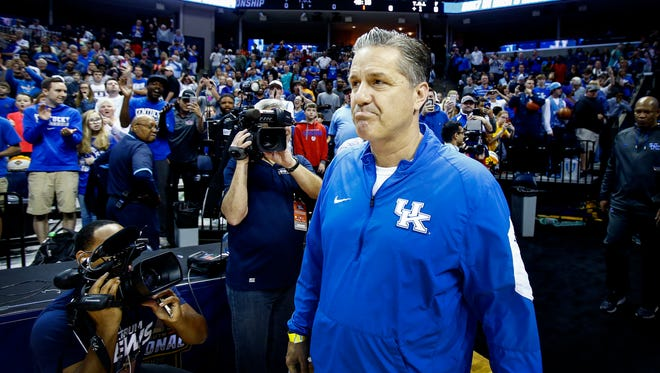 University of Kentucky's John Calipari returns to the FedExForum court for the first-time since leaving the University of Memphis to coach the Wildcats, during the NCAA South Regional Sweet Sixteen practice day.