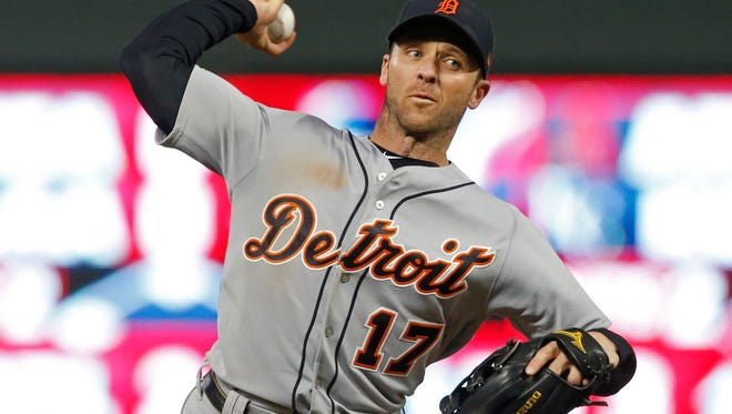 The Tigers' Andrew Romine pitches against the Twins during the eighth inning of the Tigers' 3-2 win over the Twins on Saturday, Sept. 30, 2017, in Minneapolis.