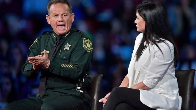 Broward Sheriff Scott Israel makes a point to NRA Spokesperson Dana Loesch during a CNN town hall meeting, Wednesday, Feb. 21, 2018, at the BB&T Center, in Sunrise, Fla.
