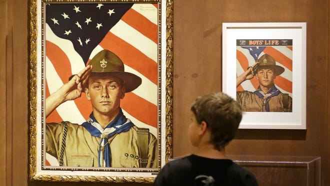 In this July 22, 2013, file photo, Andrew Garrison, 11, of Salt Lake City, looks over the Rockwell exhibition at the Mormon Church History Museum in Salt Lake City, Utah.