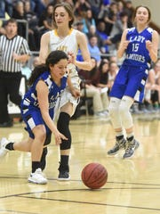 Cotter's Hanny Garay comes up with a steal during the 2018 North Arkansas Senior Showcase on Saturday night at Brockwell. Garay and Cotter teammate Alexa Wooten (15) combined for six steals during their team's 80-68 victory.