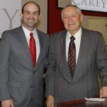 Reese Powell (left), director of library and learning resources at William Carey University, poses with Dr. Robert Fortenberry, retired superintendent of Jackson Public Schools, following Fortenberry's Feb. 25 lecture on the Hattiesburg campus.