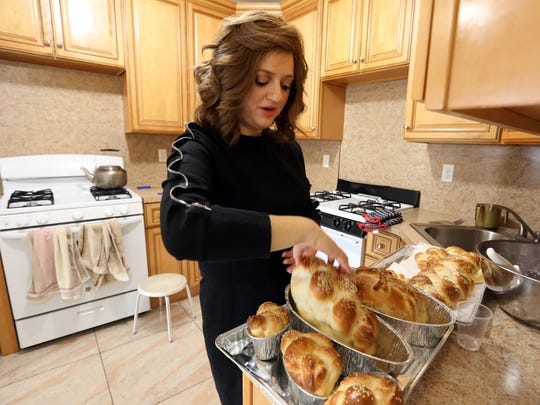 Chany Rosengarten, 30, checks the challah she just baked for Shabbos at home in Monsey April 12, 2018. Rosengarten, a Hasidic woman, grew up in the Hasidic village of New Square.