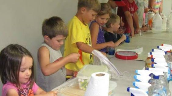 """The Science Alliance from Lake Geneva presented """"Close Encounters of the Chemical Kind"""" program at the Brownsville Public Library. Children play with the Gooey Gak creation that they made."""