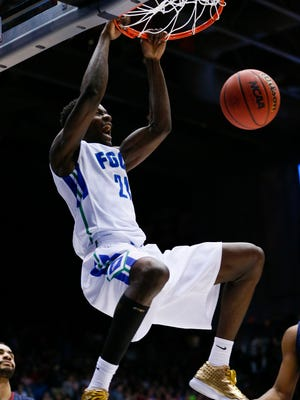 Mar 15, 2016; Dayton, OH, USA; Florida Gulf Coast Eagles forward Demetris Morant (21) dunks during the first half against the Fairleigh Dickinson Knights of First Four of the NCAA men's college basketball tournament at Dayton Arena. Mandatory Credit: Rick Osentoski-USA TODAY Sports