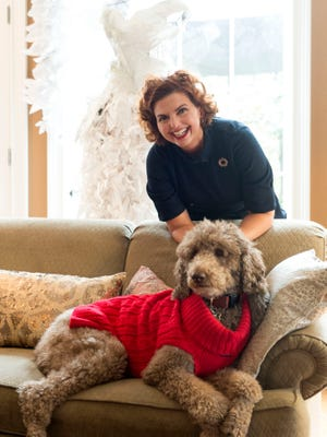 Deborah Franklin with standard poodle Ribeye in the living room of her Bearden home.