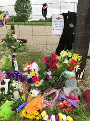 The memorial from April 2017 to Halee Rathgeber, 20, that started near the parking lot where her body was found on April 24, 2017.