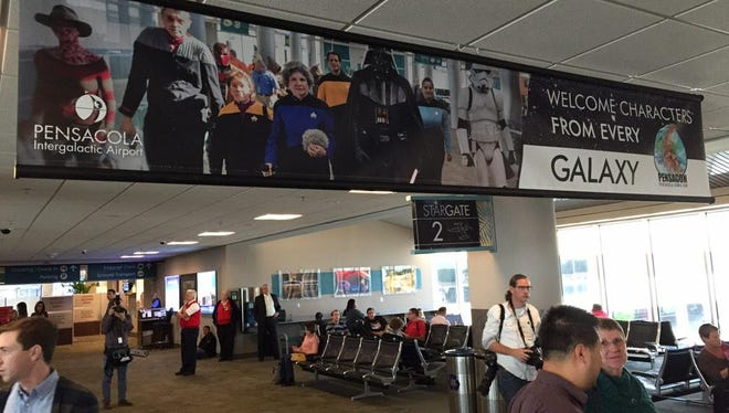 """A banner that reads """"May the force be with you! #Pensacon #FlyPensacola #FlyIntergalactic"""" welcomes Pensacon guests at the temporarily renamed Pensacola Intergalactic Airport."""