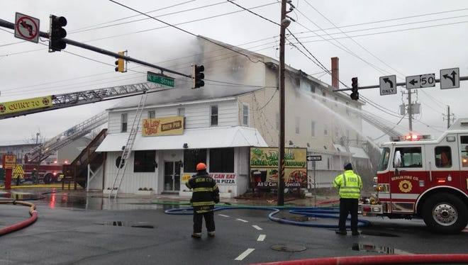 Emergency responders work to put out a fire at De Lazy Lizard brewpub on First Street in Ocean City on Tuesday, Feb. 10.