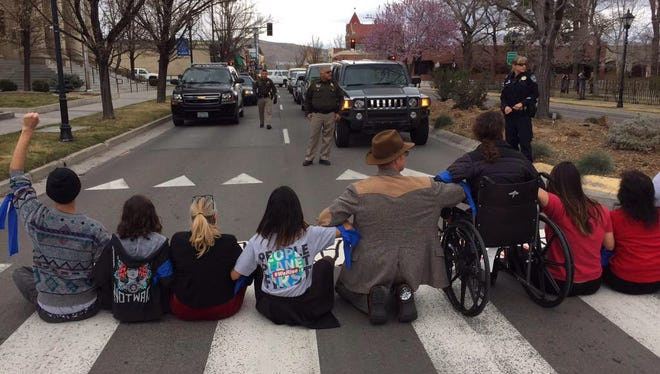 Protesters over Adam Laxalt's anti-immigration lawsuit block Carson Street.