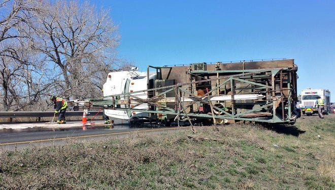 A tractor trailer rolled over about 11:30 a.m. Friday, March 20, 2015, south of Prospect Road.