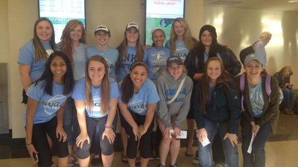 The Enka softball team flew to a tournament in Orlando, Fla., on Monday.