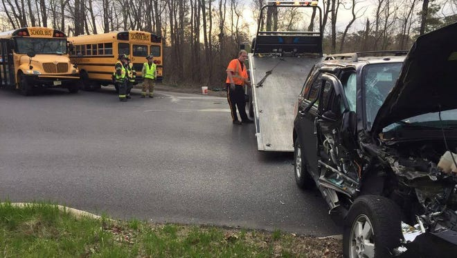 Crews clear up an accident that involved a school bus at 487 Cross Keys Road