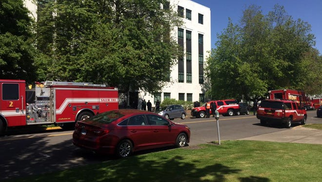Several fire trucks respond to a hazardous materials situation at the Public Service Building.
