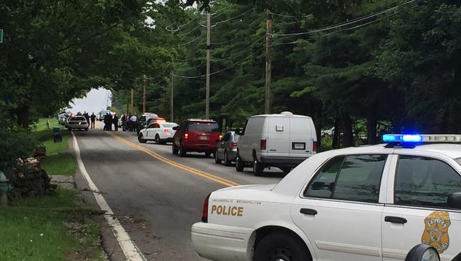 Police gather near the Glens Valley Nature Preserve on Bluff Road.