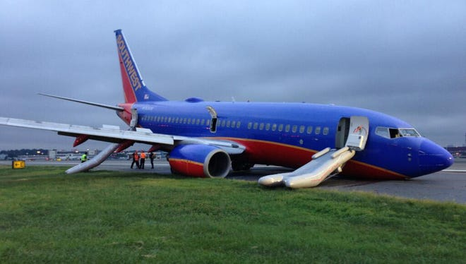 This image provided by the National Transportation Safety Board shows Southwest Airlines Flight 345 sitting on the runway at LaGuardia Airport in New York on July 22, 2013.